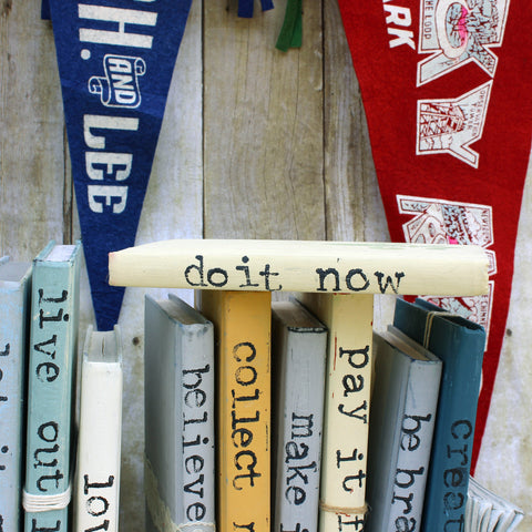 do it now repurposed book art
