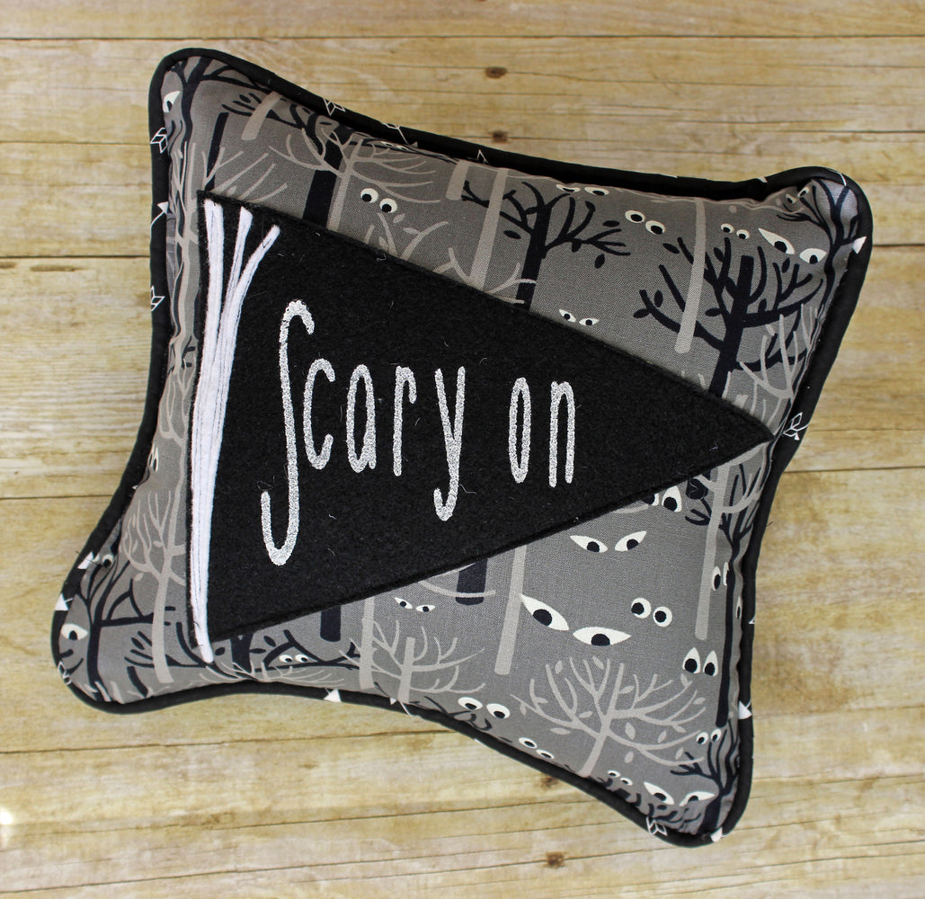 scary eyes on pennant Halloween pillow