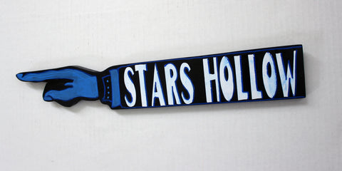 stars and hollows wooden pointy sign