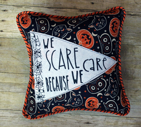 we scare because we care pennant Halloween pillow - Pretty Clever Words