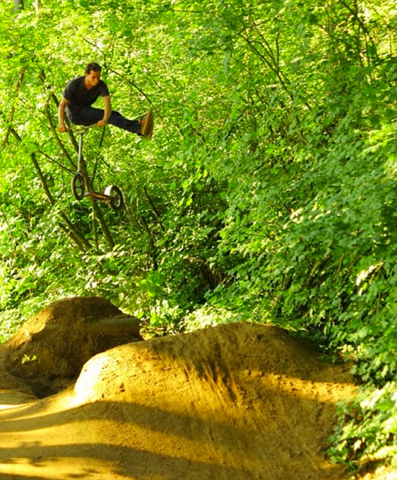 Cory Mosbrucker of RAD, no foot can-can over their hometown trails.