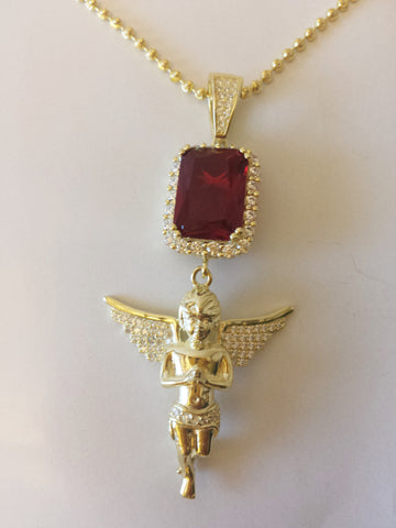 Iced Out Red Gem Attached To An Iced Out Praying Angel