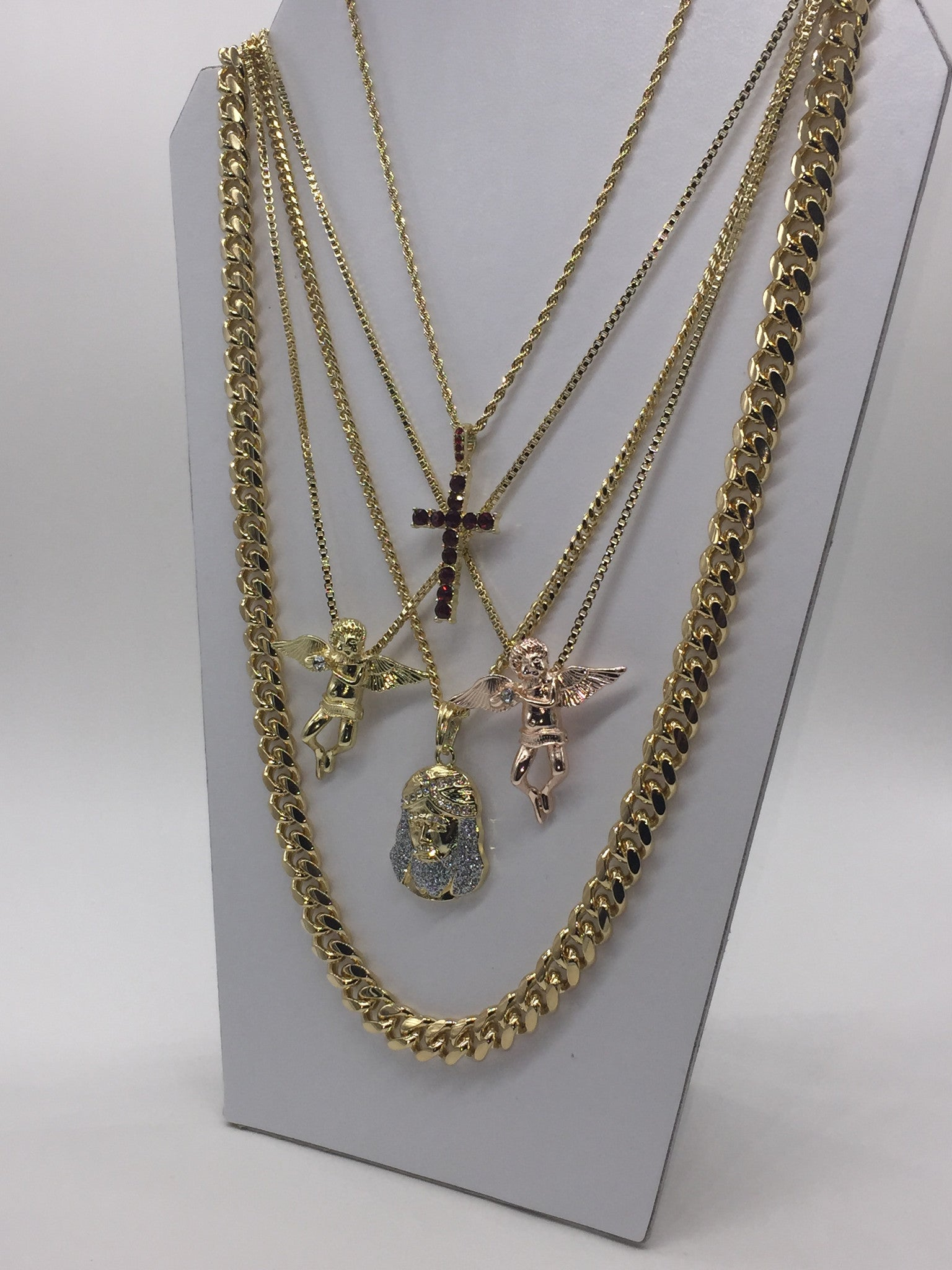 5 Chain Set: 18k Gold Plated Rose Gold Flute Angel, Gold Flute Angel, Red Ice Cross, and Iced Out Jesus Piece