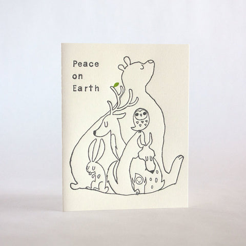 peace on earth forest animals 161b fugu fugu press letterpress card printed on recycled paper. inside of the card is blank. made in the usa