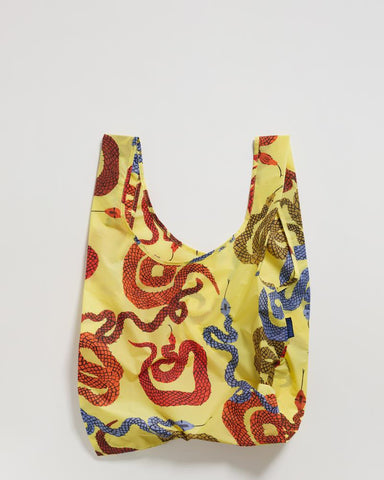standard baggu yellow snakes reusable shopping bag holds up to 50lbs. can fit over shoulder. made from 40% recycled ripstock nylon