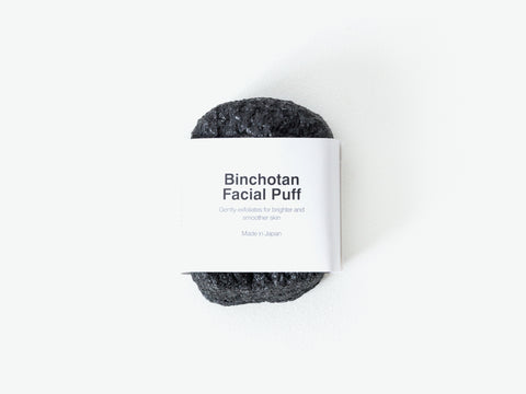 binchotan charcoal facial puff made from a blend of micro-fine binchotan charcoal powder and pure konjac vegetable fibers