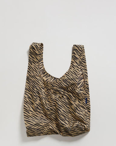 standard baggu tiger stripe reusable shopping bag holds up to 50lbs. can fit over shoulder. made from 40% recycled ripstock nylon