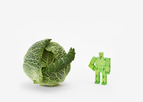areaware green micro cubebot is a robot toy that can be assembled into countless poses and folds up into a cube