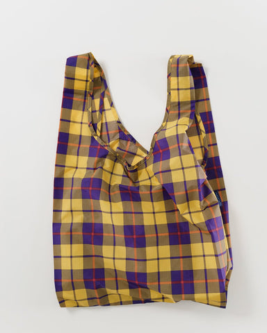 yellow tartan standard baggu reusable shopping bag holds up to 50lbs. can fit over shoulder. made from 40% recycled ripstop nylon