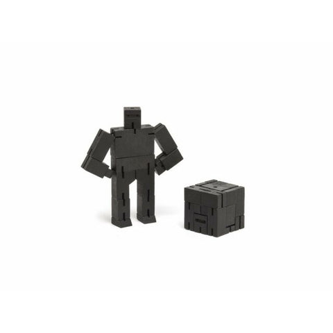 areaware black ninja micro cubebot is a robot toy that can be assembled into countless poses and folds up into a cube