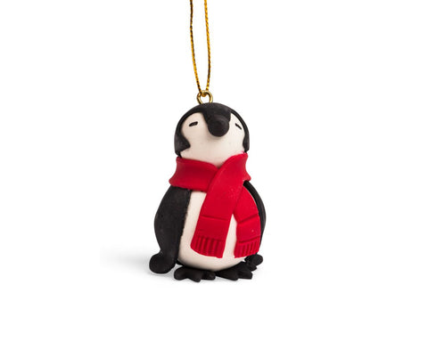 chilly penguin ornament is handcrafted from painted bread dough, in ecuador