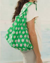 standard baggu green daisy reusable shopping bag holds up to 50lbs. made from 40% recycled ripstop nylon