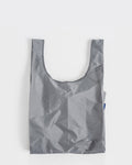 grey standard baggu reusable shopping bag holds up to 50lbs. can fit over shoulder. made from 40% recycled ripstop nylon