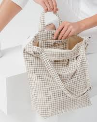 baggu natural grid duck bag is made from 65% recycled cotton canvas machine wash or hand wash cold, line dry