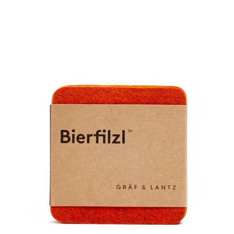 graf lantz colorful orange felted wool coasters. made in CA USA