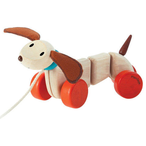 plan toys happy puppy wiggles and waggles and turns it's head when pulled. sustainable wood