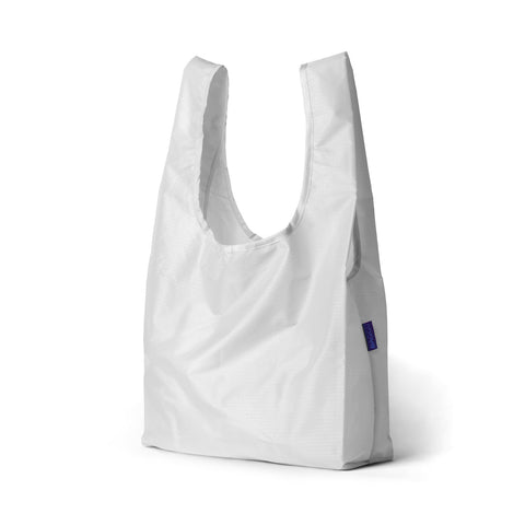 standard baggu white reusable shopping bag holds up to 50lbs. can fit over shoulder. made from 40% recycled ripstock nylon