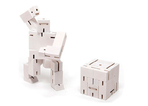 areaware white ninja micro cubebot is a robot toy that can be assembled into countless poses and folds up into a cube