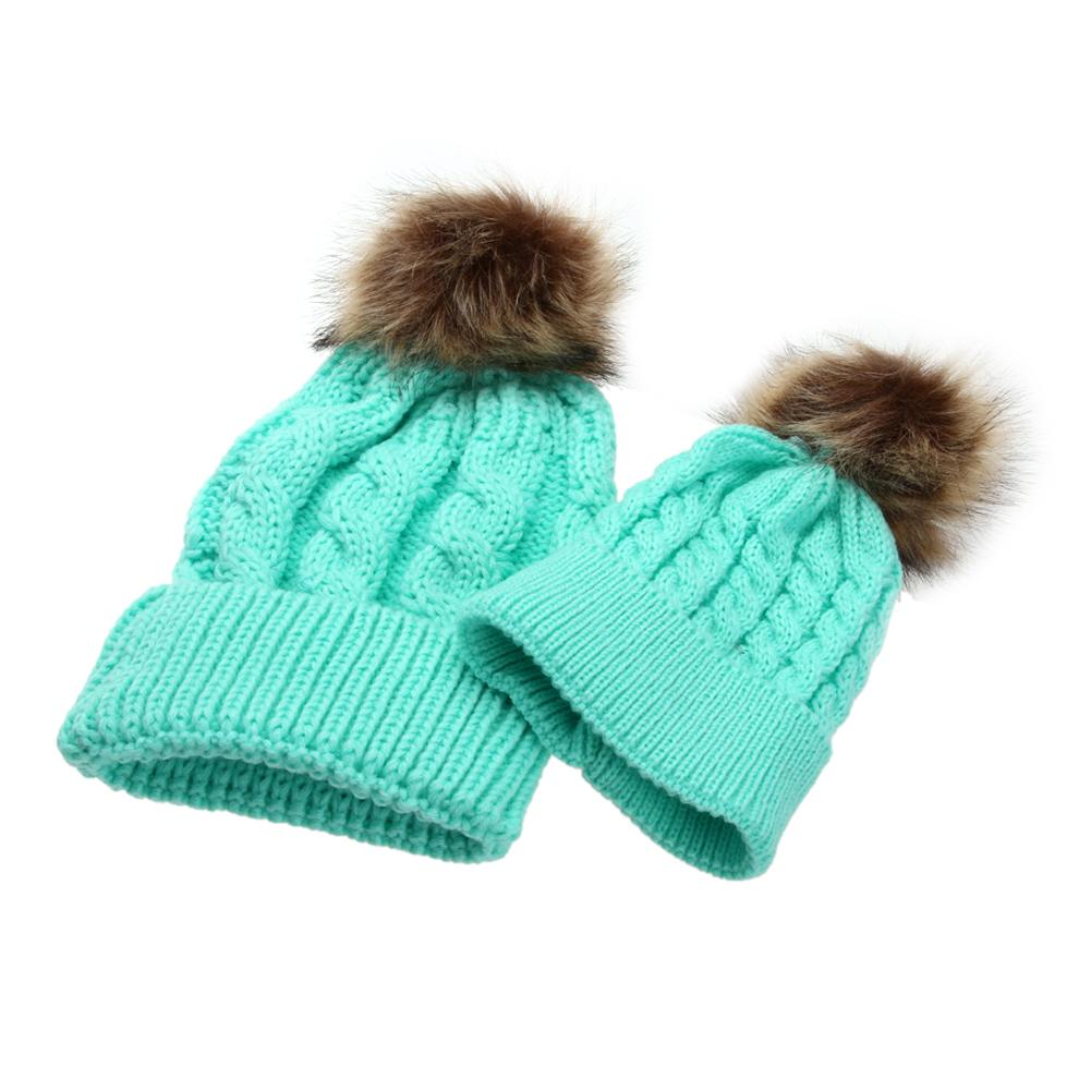 fba798519f7 ... Mom and baby matching fur beanies ...