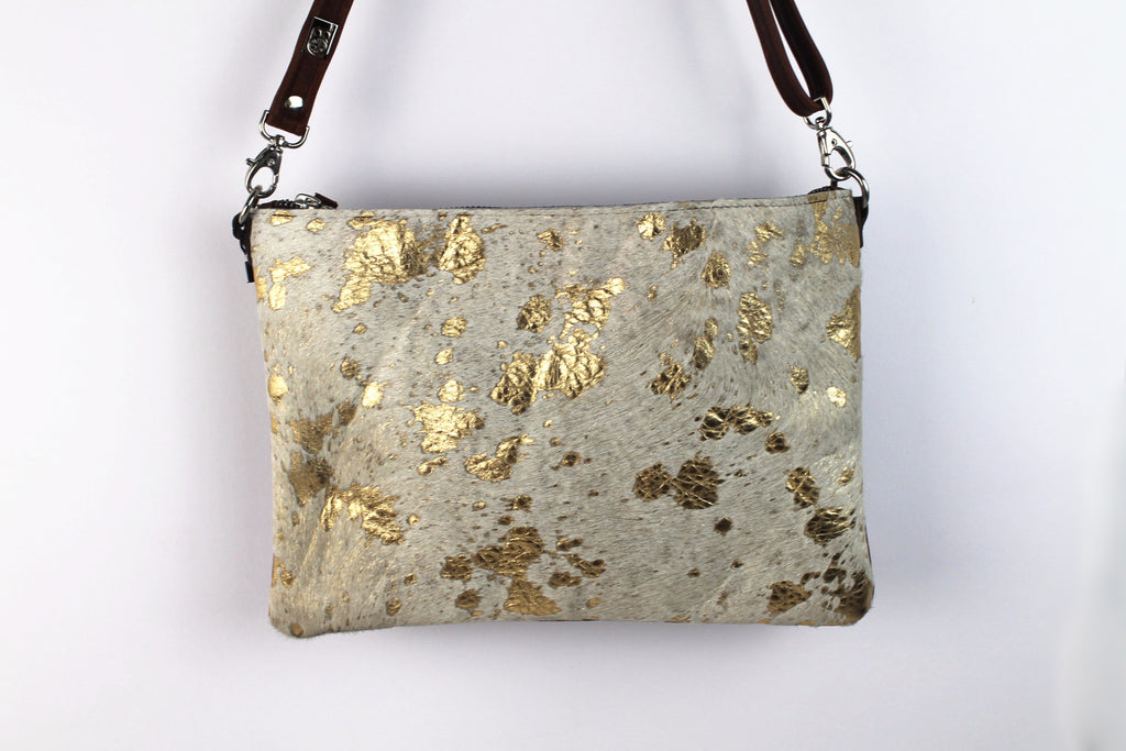 cowhide handbag with cream/gold cowhide one side and brown leather on the other side