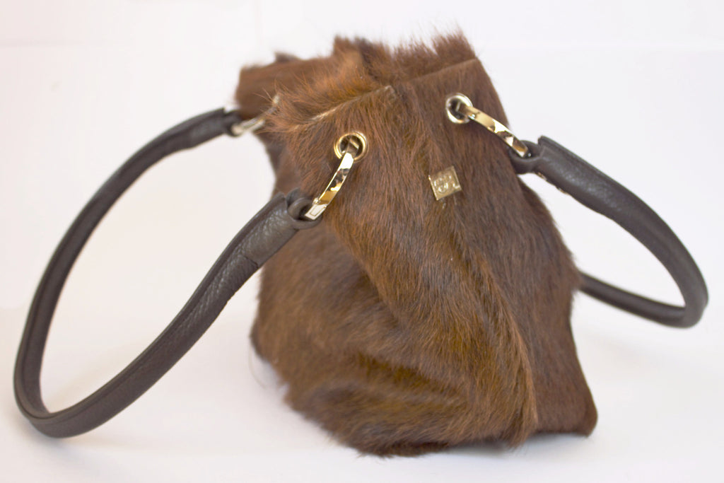 Brown cowhide tote with brown leather handles