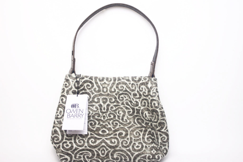 Faberge print cowhide tote with brown leather shoulder strap