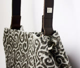 Faberge patterned cowhide tote with one leather shoulder strap