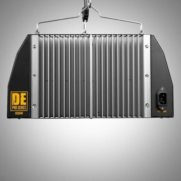 "Black rectangular grow light with yellow text ""Gorilla"" logo and light emitting from the bottom."