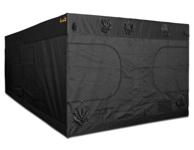 angled view of large black canvas grow tent with doors, windows, and exhaust ducts, 20' wide by 10' deep by 7' tall. Image is angled to feature the 10' side of the tent.