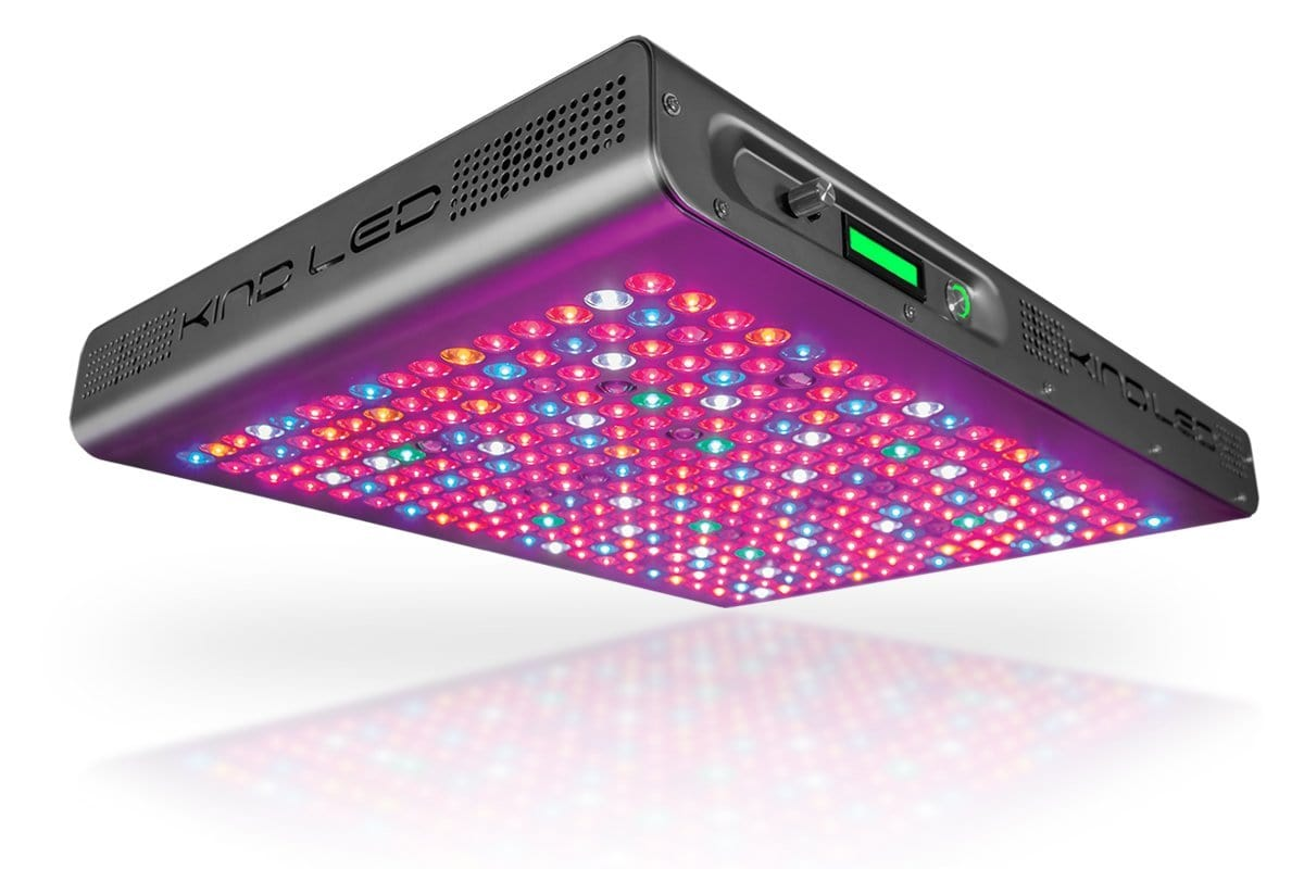Low angled view of a gray rectangular LED grow light with digital display and large array of lit mult-colored LED lights.