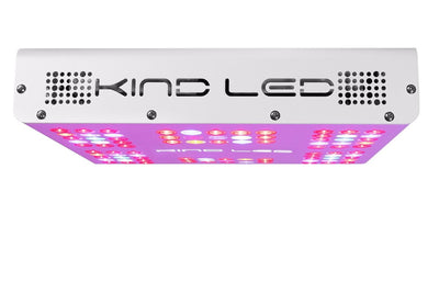 Profile view of a white rectangular KIND LED grow light with multi-colored lights illuminating from the bottom