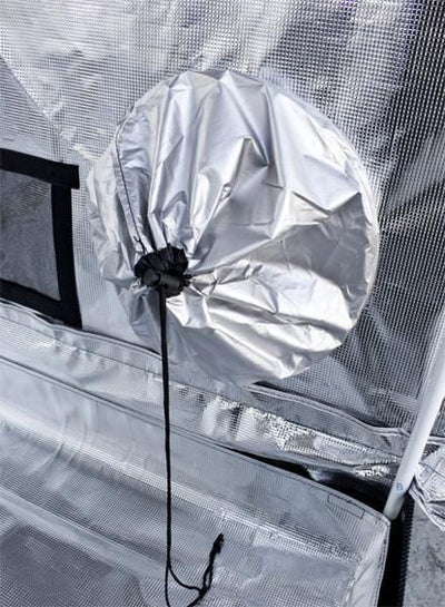 reflective interior of grow tent, with white steel poles and exhaust ducts cinched with black drawstring