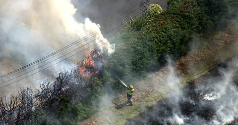 Fire by a house, Auckland