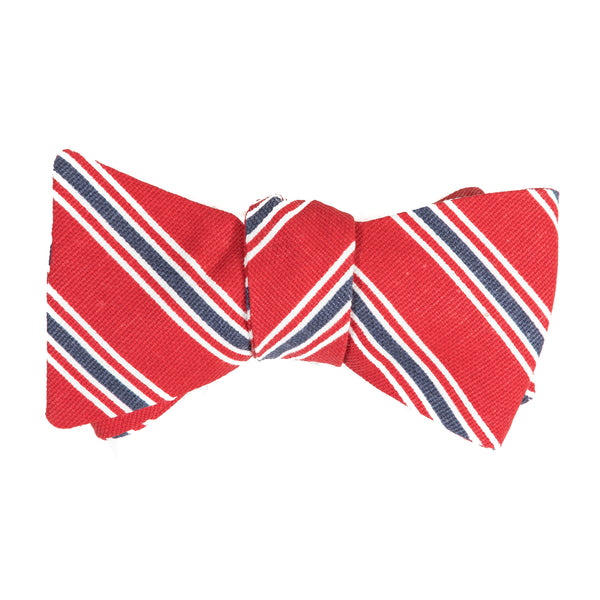 red bow tie with blue, red and white alternating stripes
