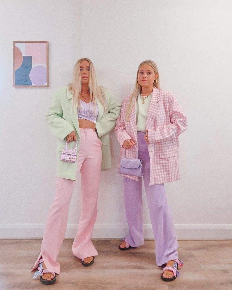 Two girls in pastel coloured outfits