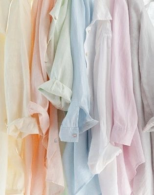 Shirts hanging in pastel colours