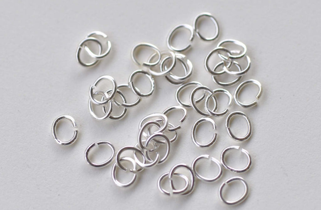 100 pcs Shiny Silver Oval Jump Rings Size 4x5mm 22G A8681