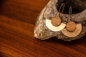 wood and metal earrings on driftwood