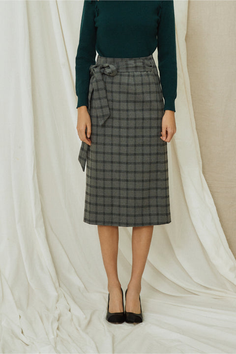 Game on plaid skirt