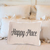 Happy Place pillow on bed