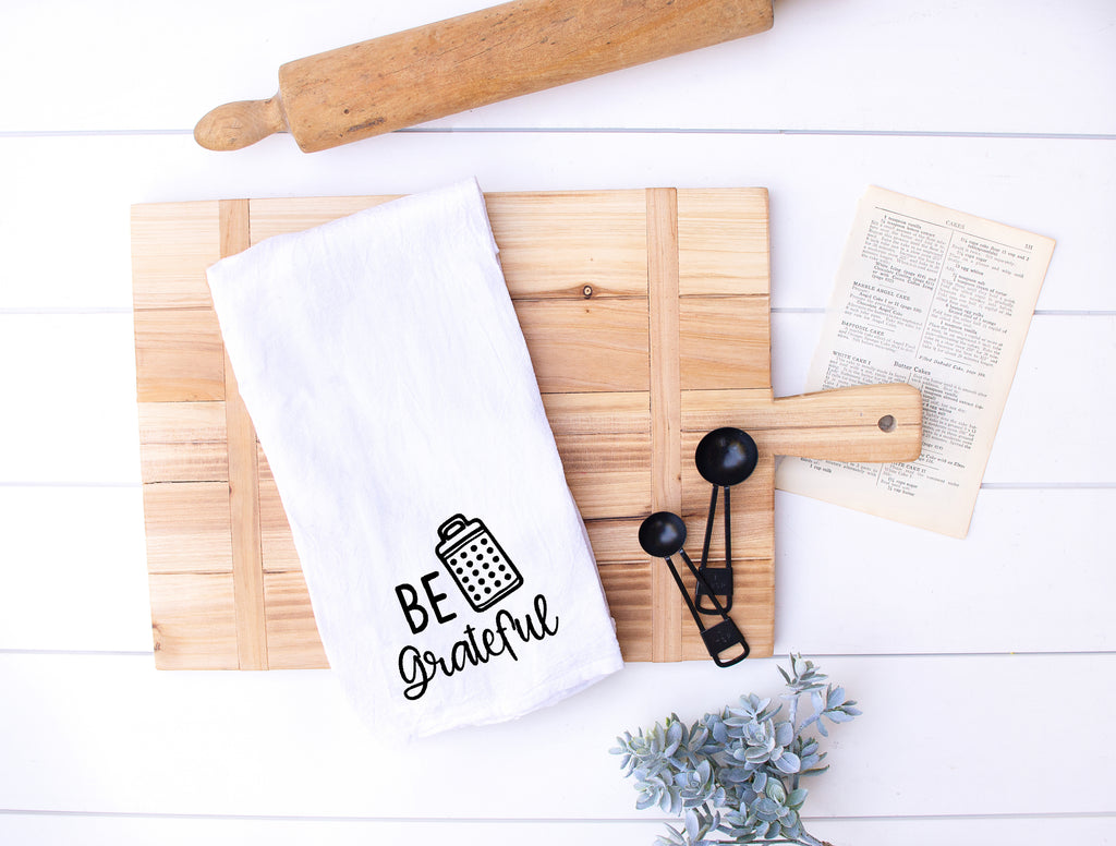Be Grateful Flour Sack Kitchen Towel on cutting board
