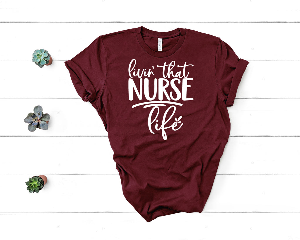Living that Nurse Life T-Shirt on maroon with white letters