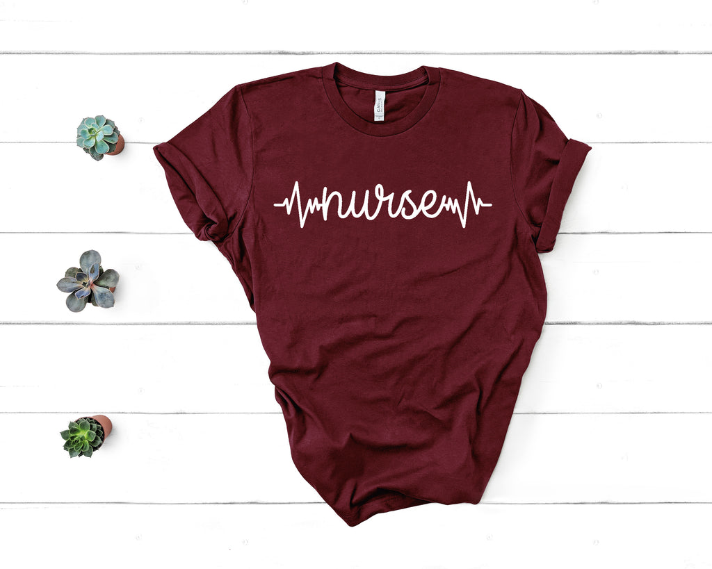 Nurse Heartbeat T-Shirt on maroon shirt