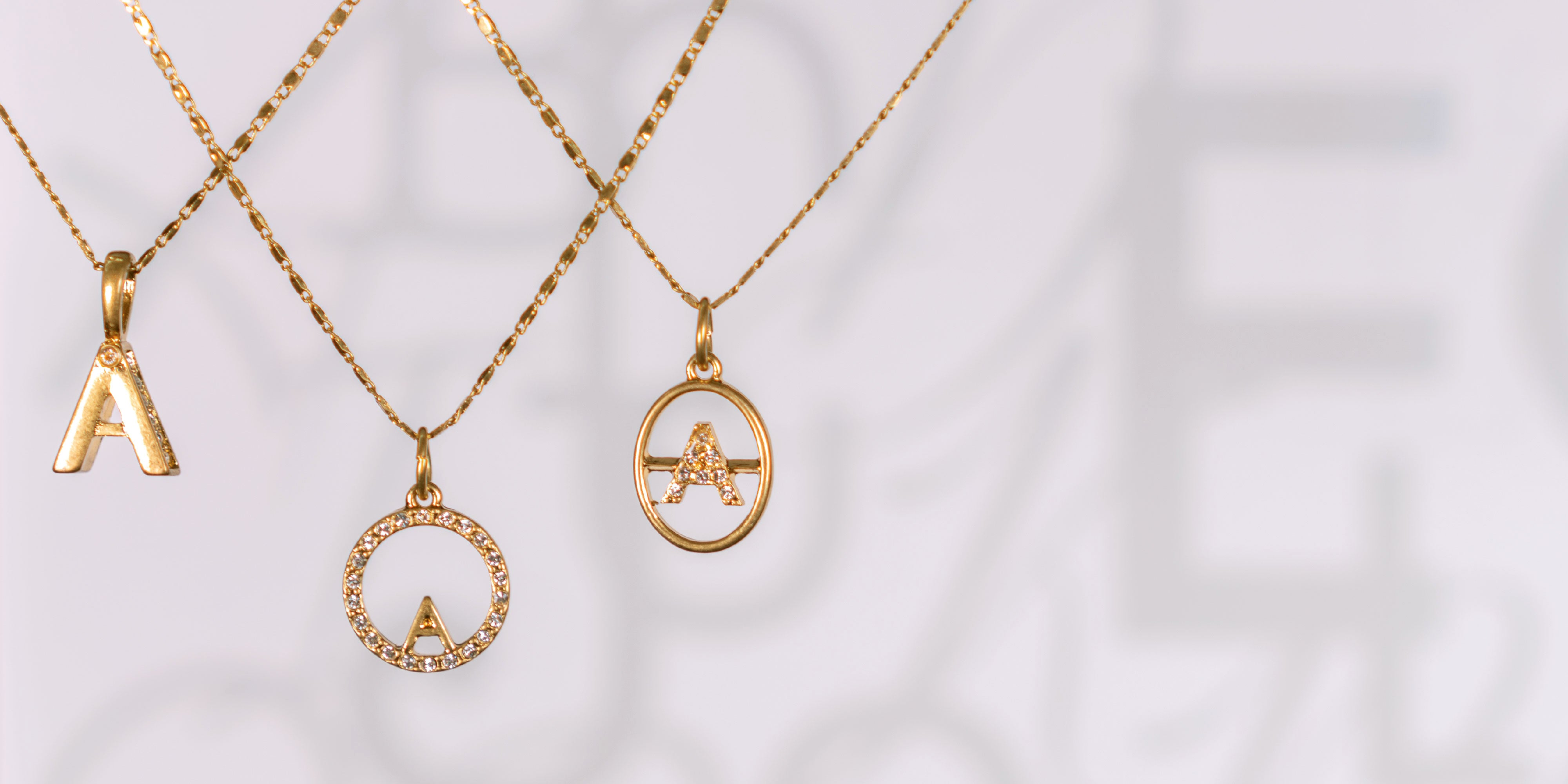 Initial Talisman Necklace Collection