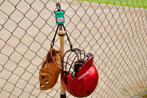 Green Dugout Gear Hanger With Hanging Equipment