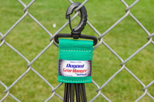 Green Dugout Organizer On Chain Link Fence Close Up