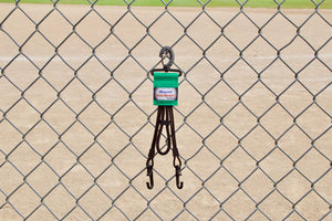 Green Dugout Organizer On Chain Link Fence