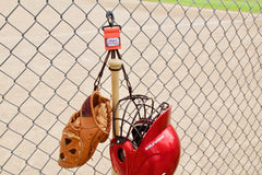 Dugout Gear Hanger With Hanging Baseball Equipment, Hanger clipped on chain link fence