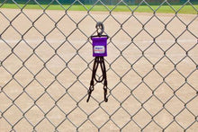 Load image into Gallery viewer, Purple Dugout Gear Hanger On Chain Link Fence