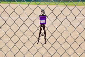 Purple Dugout Gear Hanger On Chain Link Fence